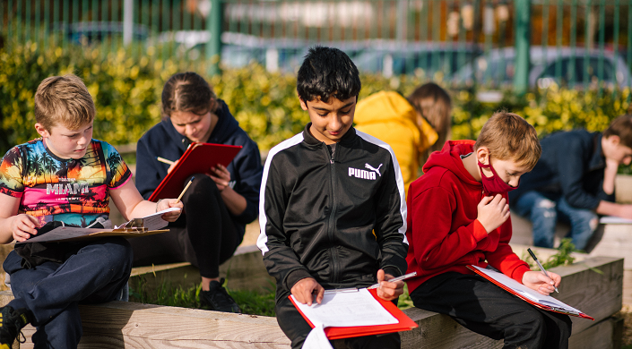 Secondary school children learn outdoors